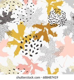 Abstract maple leaves seamless pattern in gold and grey colors. Autumn leaves filled with dots, dashes, shabby grunge texture on minimal doodle background. Vector illustration