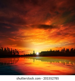 abstract nature dark background with forest lake red sunset and clouds