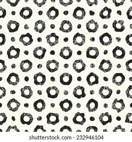 Abstract noisy textured dot and ring leopard background. Seamless pattern. Vector.