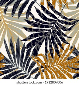 Abstract palm leaves filled with animal print. Modern trendy tropical seamless pattern. Exotic foliage background with rough texture for textile, fabric, print design