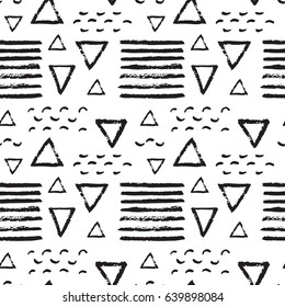 Abstract pattern of black brush strokes on white. Ink doodles. Repeatable background for stationary, posters, cards, banners, textile, clothes, curtains, tableclothes, wrapping paper, wallpaper, etc.