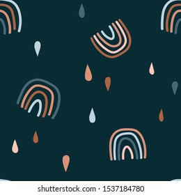 Abstract rainbows hand drawn seamless pattern. Colorful uneven geometric shapes doodle drawing. Rain drops background. Gender neutral nursery backdrop. Decorative textile, wallpaper, wrapping paper