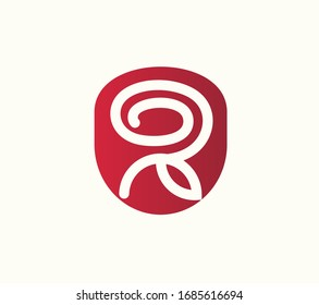 Abstract Red Rose flower logo. Spa or cosmetic emblem.  Can be used for flower store,  beauty salon.