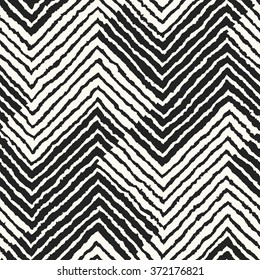 Abstract rough edges variegated striped houndstooth check motif. Seamless pattern.