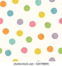 Abstract seamless pattern with bright colorful hand drawn polka dots on a white background. Lovely childish backdrop for wrapping, packaging, textile and interior decoration