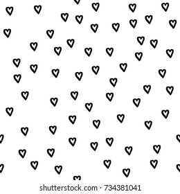 Abstract seamless pattern. Casual  dot wallpaper design element. White background with black heart hand drawn texture with heart. Valentines day seamless