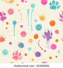Abstract seamless pattern with colorful ink splashes, blots and dog paw prints on a off-white background. Happy childish backdrop for wrapping, packaging, textile and interior decoration