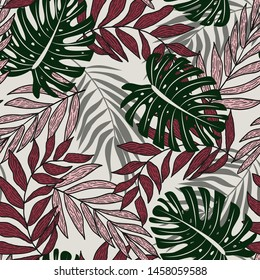 Abstract seamless pattern with colorful tropical leaves and plants on a delicate background. Vector design. Jungle print. Flowers background. Printing and textiles. Exotic tropics. Fresh design.