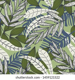 Abstract seamless pattern with colorful tropical leaves and plants on green background. Vector design. Jungle print. Flowers background. Printing and textiles. Exotic tropics. Fresh design.