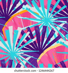 Abstract seamless pattern of exotic palm leaves in vivid colors. Bright vector design drawn in the technique of rough brush