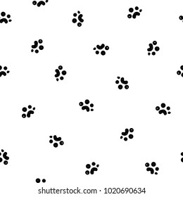 Abstract seamless paw pattern. black and white background. footprint from an animal mammal or predator. track silhouette. Monochrome repeated backdrop four textile, clothes, wrapping paper
