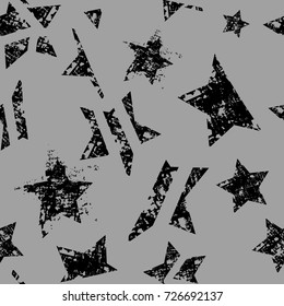 Abstract seamless stars pattern. Grunge urban repeated backdrop for textile, clothes, wrapping paper. Monochrome wallpaper with textured, shabby cracked elements.