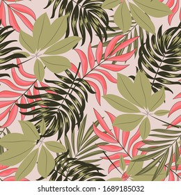 Abstract seamless tropical pattern with bright leaves and plants on a beige background. Modern abstract design for fabric, paper, interior decor. Trendy summer Hawaii print.