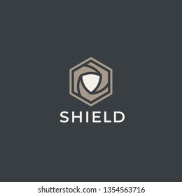 Abstract shield with hexagon box logo. Protection, teamwork, defence, security, guard, trust, guarantee, warranty symbol. Looped shield lines protection Logotype.