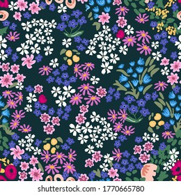 Abstract sketched flowers on black background. Seamless vector pattern. Vintage print with small inflorescences. Retro textile collection.