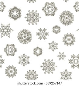 Abstract snowstorm with beige snowflakes. Winter mood background. Blow snow texture pattern on white background. Winter weather. Seamless pattern with snowflakes. Winter background. Windstorm.