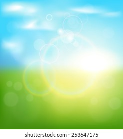 Abstract spring background with sunrise and grass