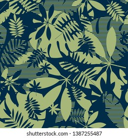Abstract tropical leaves seamless pattern in nature green. Exotic foliage silhouette repeatable motif. Tile jungle element for fabric, wrapping paper, surface design.