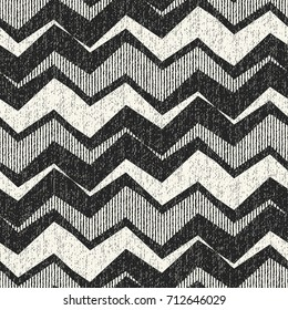 Abstract variegated zigzag motif textured distressed background. Seamless pattern.