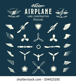 Abstract Vector Airplane Labels or Logos Construction Elements. On Blue Background.