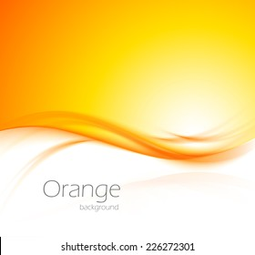 Abstract wavy orange background with light effect