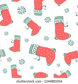 abstract wrapping paper, seamless pattern - christmas socks and white snowflakes on a white background