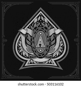 Ace of spades form with oval frame between laurel wreath and ribbon inside. Design playing card element white on black
