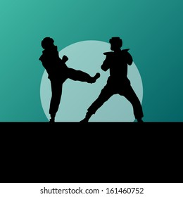 Active tae kwon do martial arts fighters combat fighting and kicking sport silhouettes in abstract sunset illustration background vector