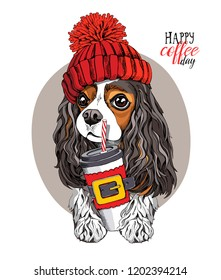 Adorable Cavalier King Charles Spaniel in a red knitted hat and with a plastic cup. Happy coffee day - lettering quote. New Year and Christmas card, t-shirt composition, handmade vector illustration.