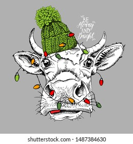 Adorable Cow in a green knitted hat and with a light. Be merry and bright - lettering quote. Christmas and New year card, Humor composition, hand drawn style print. Vector illustration.