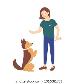 Adorable young woman dressed in casual clothes holding treat and training her dog to obey commands. Cute girl teaching her pet or domestic animal. Colorful vector illustration in flat cartoon style.
