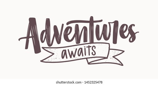 Adventure Awaits motivational message or phrase written with elegant cursive calligraphic font and decorated by ribbon. Modern lettering isolated on white background. Monochrome vector illustration.