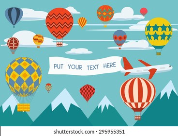 Advertising banners pulled by a plane with hot air balloons flying around.