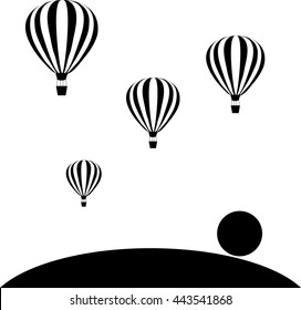 aerostats flying in sky at sunset
