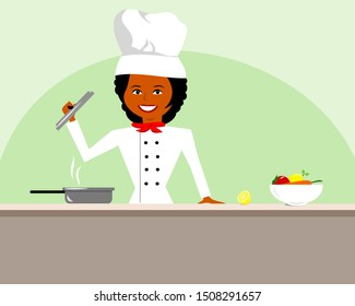African American woman in chef hat and uniform preparing food on countertop