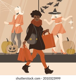 African American woman is shopping before Halloween. A girl with shopping bags walks near the windows of a clothing store. Flat vector illustration