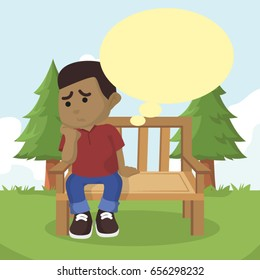 african boy sitting on bench thinking