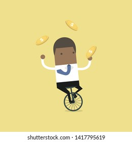 African businessman juggling coin while cycling.
