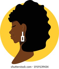 African female face with a white earring. Yellow circle. Beautiful dark skin female face on yellow background. Black life matters.