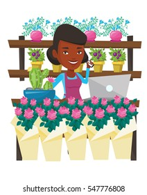 African florist standing behind the counter at flower shop. Florist using phone and laptop to take order. Woman working in flower shop. Vector flat design illustration isolated on white background.