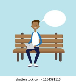 african man using laptop sitting wooden bench chat bubble character full length over blue background flat vector illustration