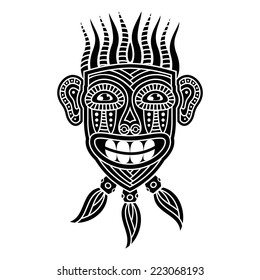 African Mask in black and white. With a broad smile. Totem Aboriginal savages.