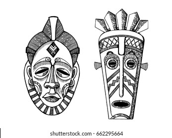 African masks of savages engraving vector illustration. Scratch board style imitation. Hand drawn image.