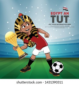 African Nations Cup 2019 - soccer player Cartoon TUT with head Tutankhamun in football stadium with decoration Party - Egypt character Amulet  - gold award cup