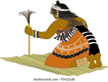African sangoma or spirit diviner kneeling on mat.