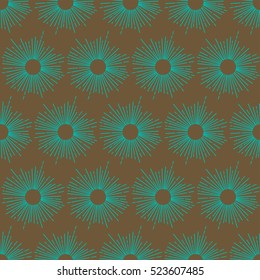 African sun shweshwe teal pattern on a brown background
