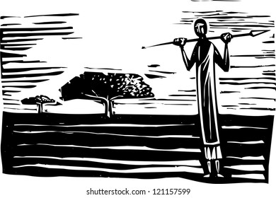 African tribal man with spear on open plain.