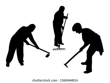 Agricultural farmers working in the field with hoe and rake
