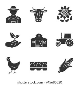 Agriculture glyph icons set. Farming silhouette symbols. Farmer, cow head, sunflower with seeds, sprout in hand, barn, tractor, chicken, eggs tray, corn. Vector isolated illustration