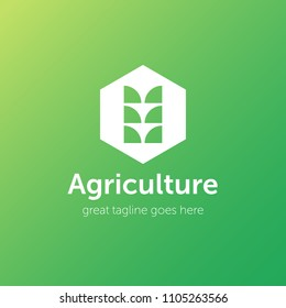 Agriculture logo with the wheat ear. Gradient background. Green colors. Eco concept for agriculture industry.
